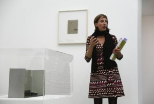 Source: Flash Art Online. Image: Stephanie Rosenthal speaking at the Lygia Clark Estudos e Maquete Exhibition, 2010. Courtesy Alison Jacques Gallery, London.