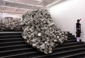 Source: IBNLive ; Image: NEW DELHI, INDIA - JANUARY 16: Indian artist Subodh Gupta's sculpture ' Thoda pani ' that is part of Gupta's first major museum show in New Delhi, 'Everything Is Inside' at National Gallery of Modern Art on January 16, 2014 in New Delhi, India. The exhibition traces Gupta's career from his upbringing in the rural province of Bihar to his rise to prominence as one of India's foremost contemporary artists. The show draws together his varied body of work including painting sculpture, video and (Photo by Graham Crouch Getty Images for Subodh Gupta/Hauser & Wirth ).
