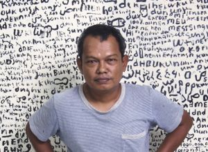 Source: Blouin Artinfo. Image: Yunizar in front of one of his works(Gajah Gallery)