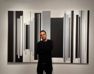 Source: artnet news: people Image: Eli Klein in front of Cui Xiuwen's Reincarnation No. 9 (2014).  Photo: Courtesy of Klein Sun Gallery.